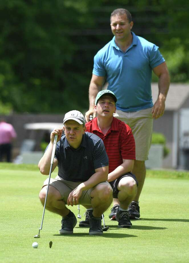 The scramble team of Stamford's Leo Cohen, left, Rye Brook, N.Y.'s Sean Hofer, center, and Stamford's Randy Krausman line up a putt during the first annual Abilis Sound Therapy Golf Scramble Griffith E. Harris Golf Course in Greenwich, Conn. Wednesday, June 12, 2019. 100 golfers participated in the shotgun-start golf scramble, which included a continental breakfast, lunch, open bar and prizes. More than $20,000 was raised from the event to benefit the Abilis sound therapy program, as well as other unfunded therapies provided by the organization. Abilis is a Greenwich-based non-profit organization that provides services and support for more than 700 individuals with special needs and their families. Photo: Tyler Sizemore / Hearst Connecticut Media / Greenwich Time