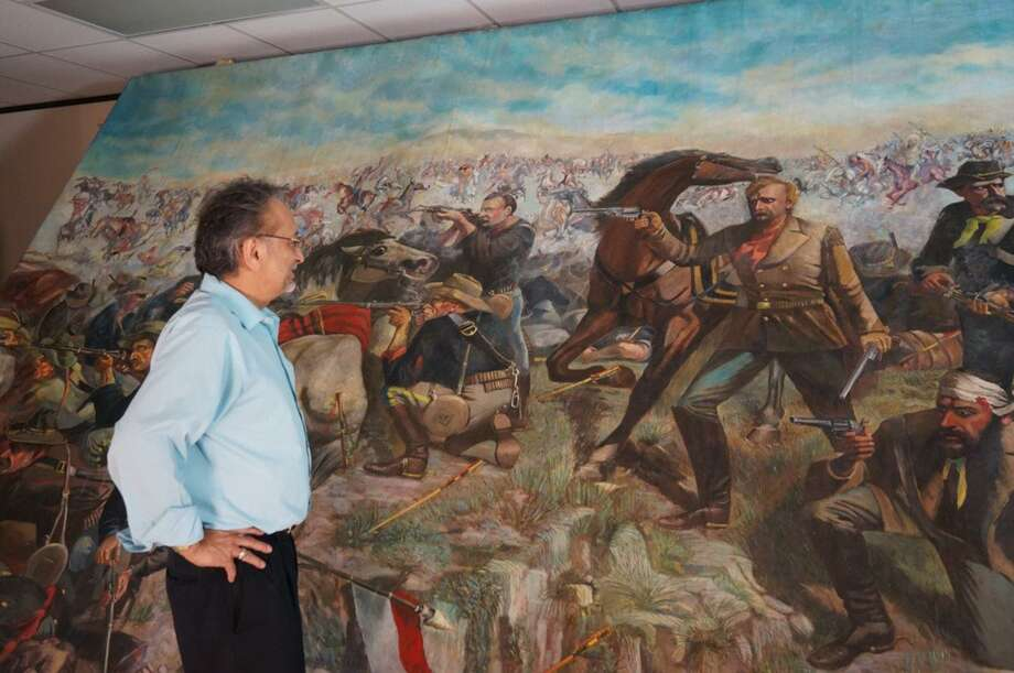 "Tony Webber, CEO of Houston-based Southwest Museum Services, stands next to ""Custer's Last Rally,"" artist John Mulvany's 11-by-20-foot painting depicting George Armstrong Custer at the Battle of Little Bighorn in 1876. Charles Trois, the painting's owner, used it as collateral on a $2.5 million loan. The painting was transferred to Webber for safekeeping under a bailment agreement. Photo: Mark Nickel /Courtesy"