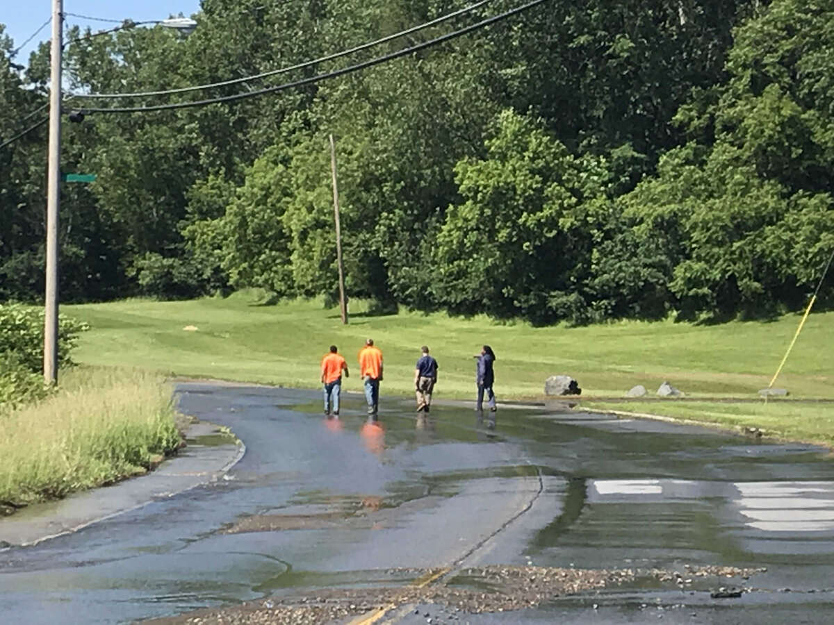 Troy officials respond to a water man break Wednesday June 12, 2019 on Oakwood Avenue.