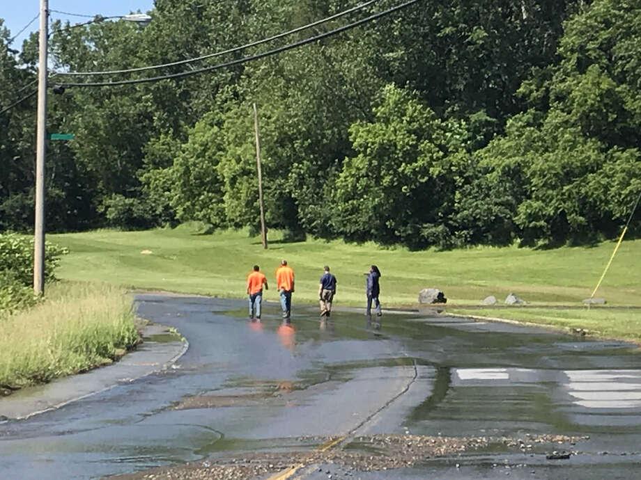Troy officials respond to a water man break Wednesday June 12, 2019 on Oakwood Avenue. Photo: Kenneth C. Crowe II