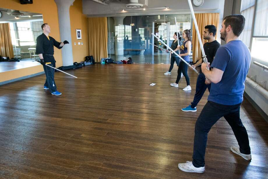Instructor Michael Christopher (left) teaches a beginning lightsaber combat technique class. The SF academy of LudoSport practices sparring and lightsaber techniques every Saturday at Studiomix in San Francisco. Photo: Douglas Zimmerman/SFGate.com