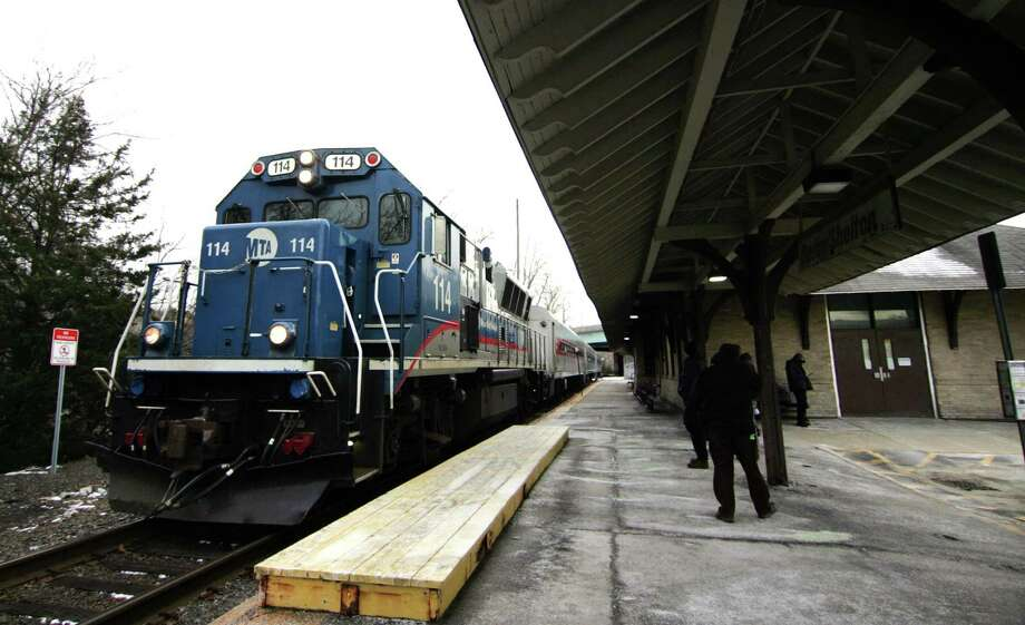In a January 2018 photo, a Metro-North train pulls into the Derby/Shelton station in Derby. A Metro-North passenger was arrested Tuesday at the station and was charged with assaulting a train conductor. Photo: Christian Abraham / Hearst Connecticut Media / Connecticut Post