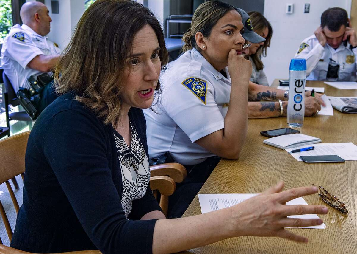 Hilary Hahn, project director ofYale Childhood Violent Trauma Center, left, and New Haven Police Department's Lt. Manmeet Colon during a meeting at the Yale Child Study Center.