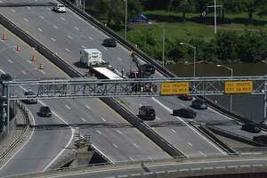 A truck hauling garbage rolled over on the Dunn Memorial Bridge on Wednesday, June 12, 2019 in Albany, NY. (Phoebe Sheehan/Times Union)