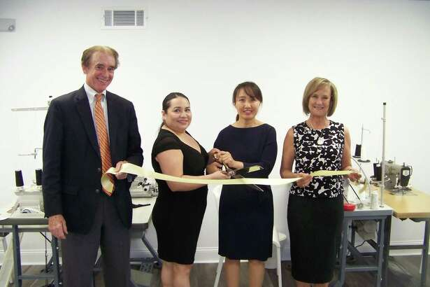 SEW GOOD: From left, Wallingford Mayor William Dickinson, owner Manuela D'Orlando, owner Chong Kim and Quinnipiac Chamber of Commerce Executive Director Dee Prior-Nesti celebrate the grand opening of Kimmel Stitches, 69 N. Turnpike Road, Suite 1, May 28. The new tailoring, alterations and upholstery shop alters clothing, including formal attire and uniforms; custom sew and repair pillows, drapes and shades; and even reupholster furniture. Visit them on the web at www.kimmelstitches.com.
