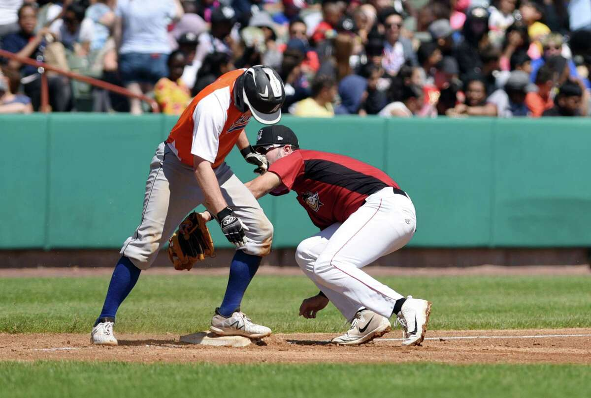 Tri-City ValleyCats third baseman Joe Perez attempts to tag out Dutchmen's Ryan McGee during an exhibition game against the Albany Dutchmen on Wednesday, June 12, 2019 at Bruno Stadium in Troy, NY. (Phoebe Sheehan/Times Union)
