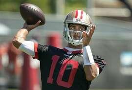 San Francisco 49ers quarterback Jimmy Garoppolo throws a pass during a drill at the team's NFL football training facility in Santa Clara, Calif., Tuesday, June 10, 2019. (AP Photo/Tony Avelar)