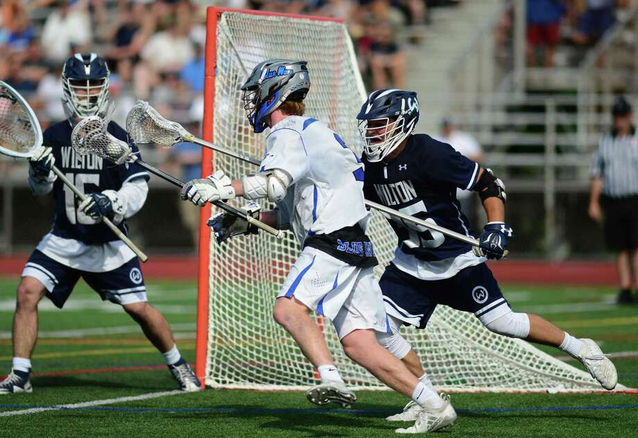Blue Wave #3 Hudson Pokorny bears down on Warrior goalie Andrew Calabrese and #35 Drew Herlyn as The Darien High School Blue Wave takes on the Wilton High School Warriors in their Class L boys lacrosse championship Saturday, June 8, 2019, at Brien McMahon High School in Norwalk, Conn. Photo: Erik Trautmann / Hearst Connecticut Media / Norwalk Hour