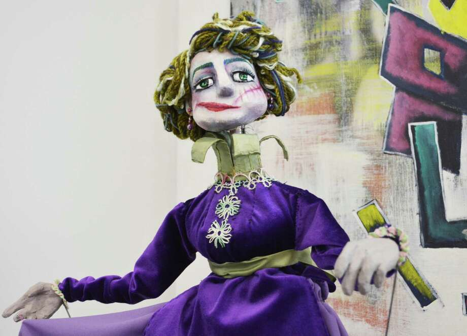 """""""Neda Izadi: Puppets, Masks, and Design,"""" is on display at the Russell Library, 123 Broad St., Middletown through July 30. Izadi is an Iranian puppeteer studying at the University of Connecticut. Shown here is a rod puppet, """"Beautify,"""" made with papier mâché, fabric and mixed media. Photo: Cassandra Day / Hearst Connecticut Media"""