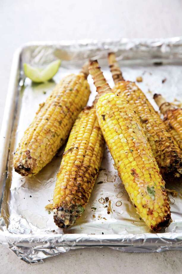 "Mexican Street Corn. This recipe appears in the cookbook ""The New Essentials Cookbook."" (Joe Keller/America's Test Kitchen via AP) Photo: Joe Keller / ©2012 Keller and Keller"