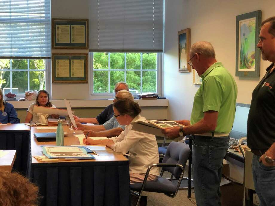 Norwalk resident Larry Andronaco presented photos of damage to his property due to flooding at a Conservation Commission meeting on Tuesday, June 11, 2019. Photo: Kelly Kultys / Hearst Connecticut Media