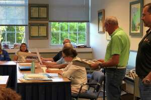Norwalk resident Larry Andronaco presented photos of damage to his property due to flooding at a Conservation Commission meeting on Tuesday, June 11, 2019.