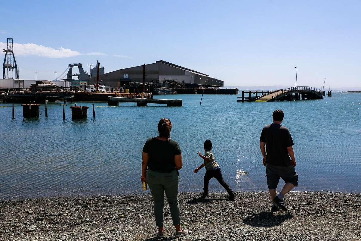 (l-r) Samra Gugsa, Mark Bingel- McKillips and Amir Stevenson, 8 skip rocks in the Bay at Heron's Head Park in San Francisco, California, on Wednesday, June 12, 2019.