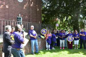 """Members of SEIU 32BJ rally at Norwalk City Hall on Wednesday, marking the annual """"Justice for Janitors"""" commemorative day and bringing attention to an upcoming contract negotiation with the owners of large office buildings in Connecticut and the New York City region."""
