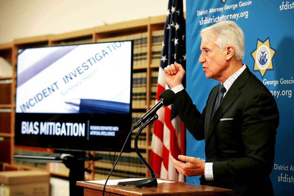 """San Francisco District Attorney George Gascon answers a question from the media during a press conference at the San Francisco District Attorneys Office, in San Francisco, Calif., on Wednesday, June 12, 2019. Gascon announced a new """"blind charging"""" process in which his office will begin using a new tool to remove race and other information when deciding whether to charge criminal suspects. The artificial intelligence tool was developed by the Stanford Computational Policy Lab at the request of the DA's office. The system will automate the process of first review to quickly assess the case, so prosecutors can determine if they're going to have enough evidence to move forward. It removes all references to race and gender along with things that can be proxies for race, like addresses and names. The goal is to eliminate any possible racial bias in the system while creating a model for other district attorneys across the country."""