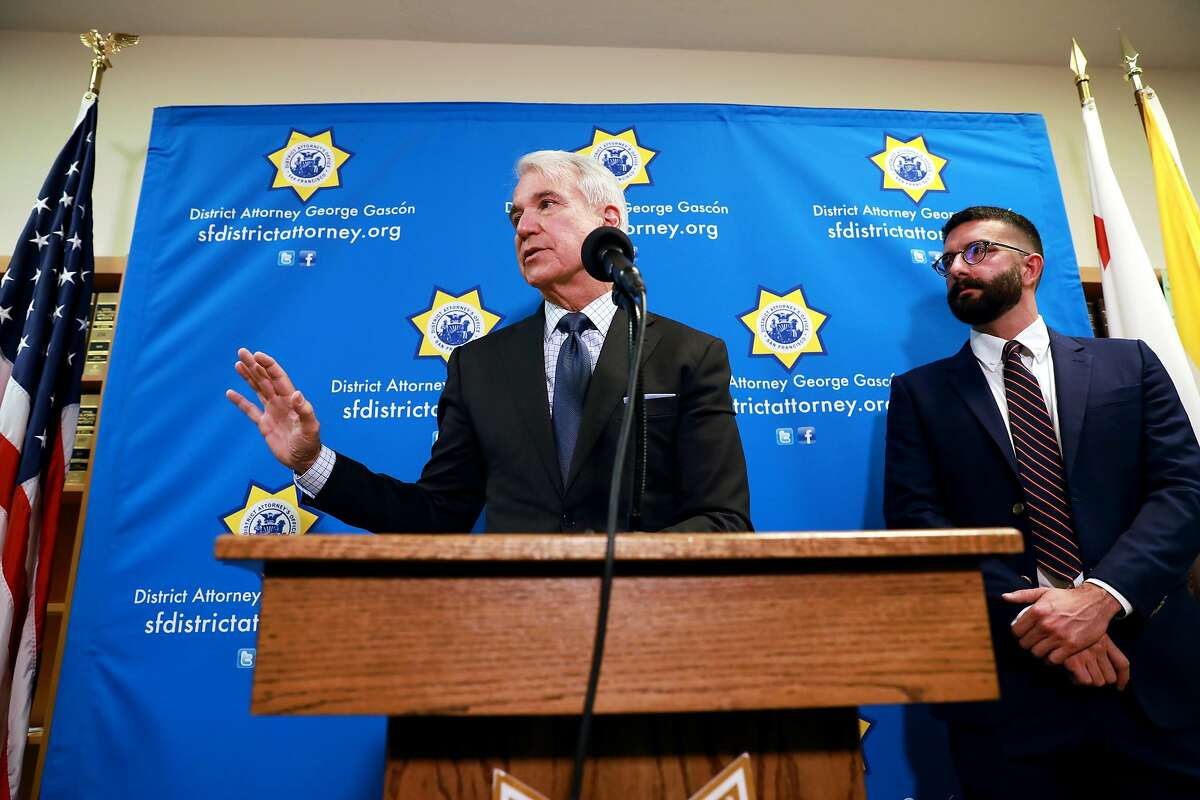 """San Francisco District Attorney George Gascon (left) and Alex Chohlas-Wood, deputy director, Stanford Computational Policy Lab, address the media during a press conference at the San Francisco District Attorneys Office, in San Francisco, Calif., on Wednesday, June 12, 2019. Gascon announced a new """"blind charging"""" process in which his office will begin using a new tool to remove race and other information when deciding whether to charge criminal suspects. The artificial intelligence tool was developed by the Stanford Computational Policy Lab at the request of the DA's office. The system will automate the process of first review to quickly assess the case, so prosecutors can determine if they're going to have enough evidence to move forward. It removes all references to race and gender along with things that can be proxies for race, like addresses and names. The goal is to eliminate any possible racial bias in the system while creating a model for other district attorneys across the country."""