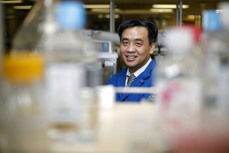 Dr. Charles Chiu stands in a lab at UCSF in San Francisco, California, on Tuesday, Jan. 26, 2016.
