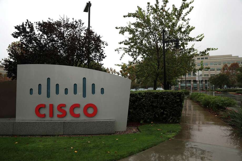 SAN JOSE, CA - NOVEMBER 16:  A sign is posted in front of the Cisco headquarters on November 16, 2017 in San Jose, California.  Cisco Systems reported a better-than-expected first quarter earnings with revenue of $12.14 billion that beat analysts expectations of $12.11 billion.  (Photo by Justin Sullivan/Getty Images) ORG XMIT: 775079794 Photo: Justin Sullivan / 2017 Getty Images