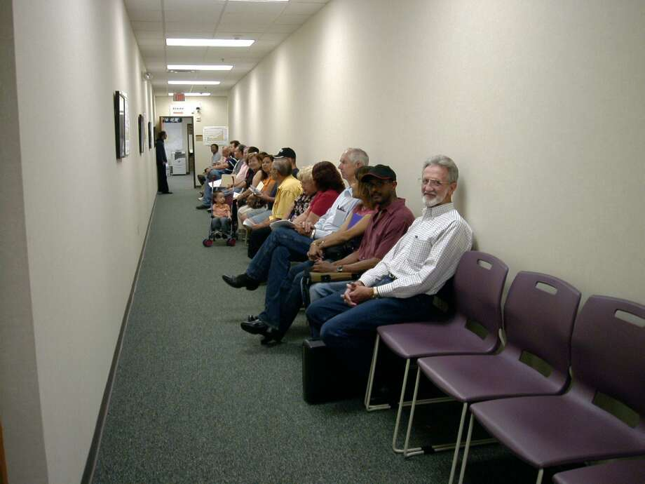 The line on the second floor of the Bexar Appraisal District, where people are in line for an informal meeting with an appraiser. The BAD is not to blame for the increase in property taxes — it's the investors. Photo: JENNIFER HILLER /SAN ANTONIO EXPRESS-NEWS / SAN ANTONIO EXPRESS-NEWS