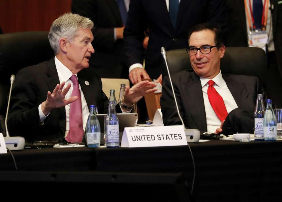 The job of Federal Reserve Chair Jerome Powell, left, with U.S. Treasury Secretary Steven Mnuchin last week, is not to help President Donald Trump score political points. Photo: Kim Kyung-Hoon /Bloomberg / © 2019 Bloomberg Finance LP