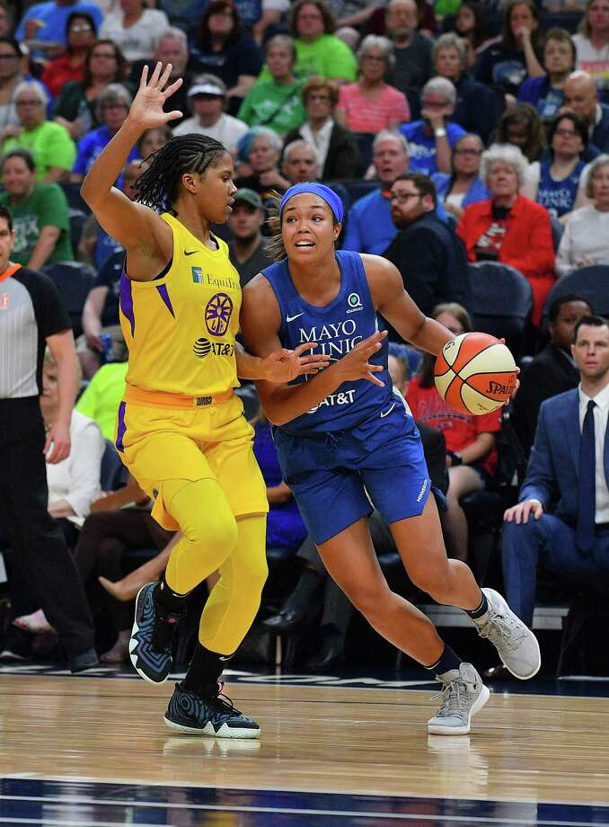MINNEAPOLIS, MINNESOTA - JUNE 08: Napheesa Collier #24 of the Minnesota Lynx drives against Tierra Ruffin-Pratt #10 of the Los Angeles Sparks during their game at Target Center on June 08, 2019 in Minneapolis, Minnesota. NOTE TO USER: User expressly acknowledges and agrees that, by downloading and or using this photograph, User is consenting to the terms and conditions of the Getty Images License Agreement. (Photo by Sam Wasson/Getty Images) Photo: Sam Wasson / Getty Images / 2019 Sam Wasson 2019 Sam Wasson