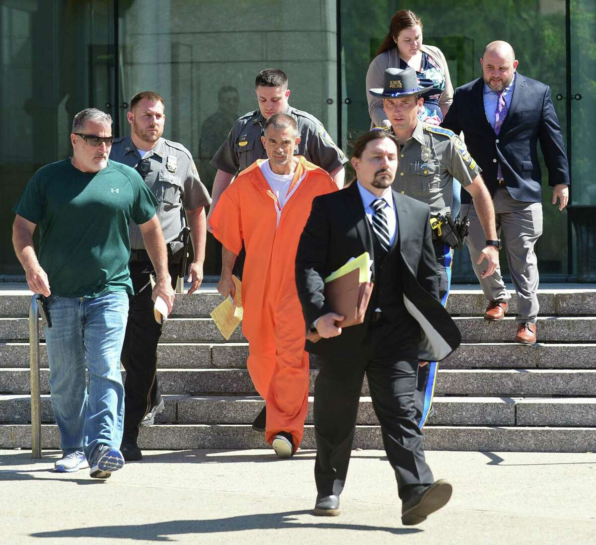 Fotis Dulos exits Stamford Superior Court with bondsman, state police and judicial marshals after posting $500,000 bond for charges of tampering with evidence and hindering the investigation into the disappearance of his wife, Jennifer Dulos, Tuesday, June 11, 2019 in Stamford, Conn.