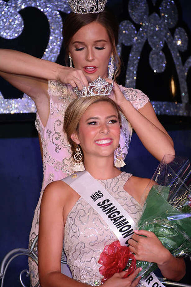 Toby Giganti, 18, is crowned 2019 Miss Sangamon County Fair by 2018's queen, Chloe Leonard, on Tuesday night at the county fairgrounds in New Berlin. Giganti, who just finished her freshman year at the University of Illinois at Urbana-Champaign, competed with 12 other contestants to claim the title. First runner-up was Savannah Norris, second runner-up was Lauryn Leonard, third runner-up was Sarah Hudspeth and fourth runner-up was Sydney Geyston. Photo: David Blanchette | For The Journal-Courier
