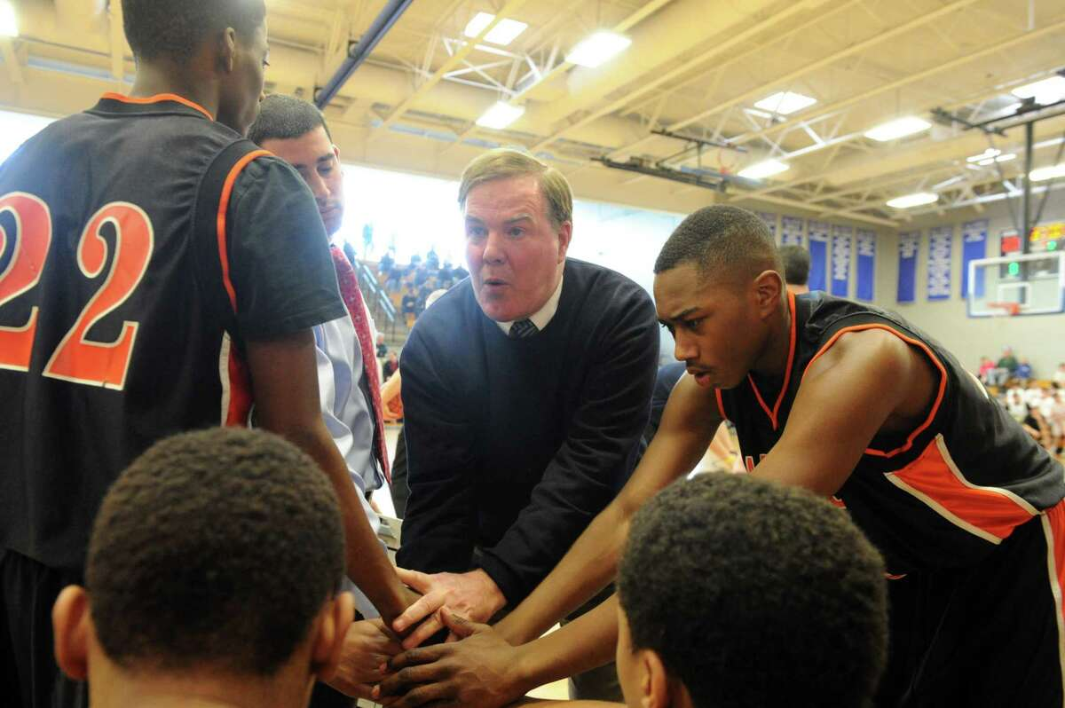 Stamford coach Jim Moriarty talks with his team during a timeout against Ridgefield in the FCIAC tournament semifinals on Feb. 25, 2012 at Ludlowe High in Fairfield.