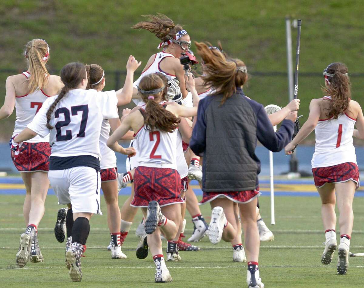New Fairfield celebrates winning the SWC championship game against Pomperaug on May 22.
