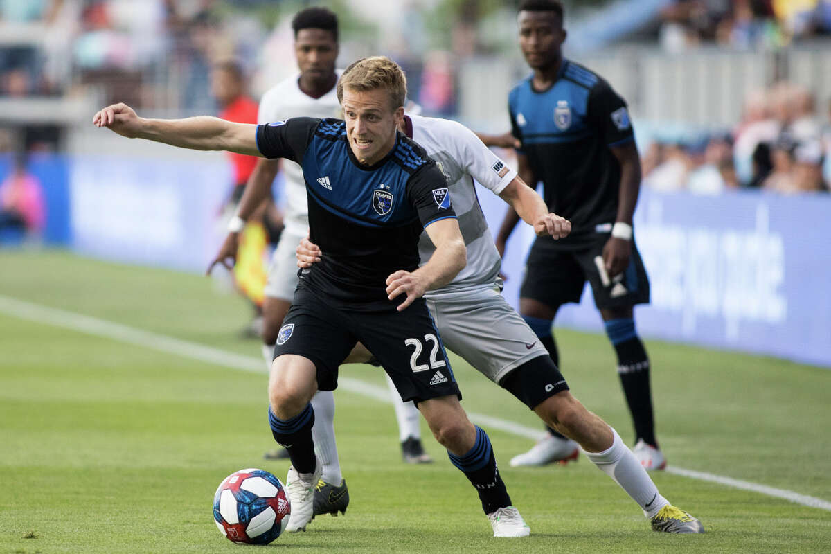 San Jose's Tommy Thompson (11) holds the ball while being pressured by Sacramento's Drew Skundrich (12) in a US Open Cup game at Avaya Stadium in San Jose on June 11, 2019. (ISI Photos / Douglas Zimmerman)