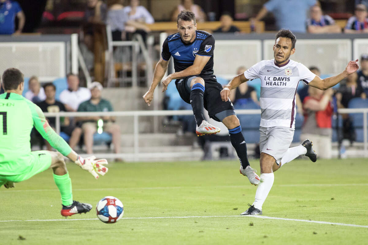 San Jose's Vako (11) scores the eventual game wining goal while Sacramento's Jamie Villarreal (24) looks on in a US Open Cup game at Avaya Stadium in San Jose on June 11, 2019. (ISI Photos / Douglas Zimmerman)