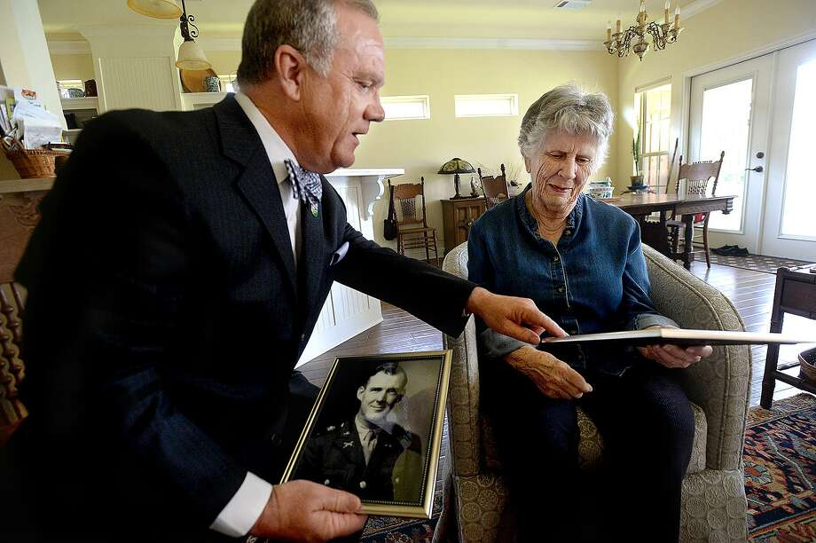 Lamar State College - Orange President Thomas Johnson meets with Pat Tilley, whose brother-in-law Bill Tilley was killed in North Africa in WWII, as Johnson informs her that the college's new gator mascot is being named Tilley in his honor. Johnson brought with him old photographs of Bill, which he gave to Pat. His servi e photo, which will be colorized, will be on display along with the gator mascot at the college. Photo taken Wednesday, June 12, 2019 Kim Brent/The Enterprise Photo: Kim Brent / The Enterprise / BEN