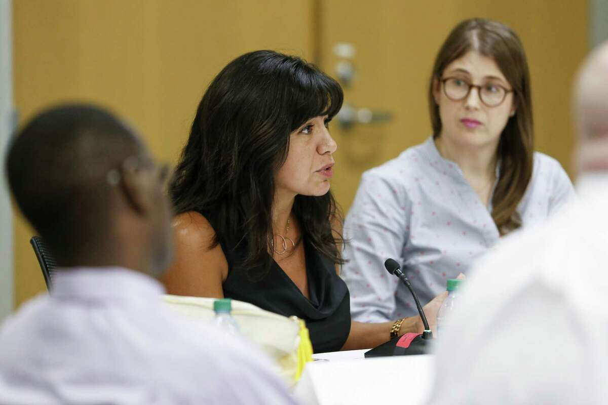 In this 2018 file photo, Houston ISD board member Diana Davila, left, talks during discussions before the HISD board approves the district's $2 billion budget. (Michael Ciaglo / Houston Chronicle)