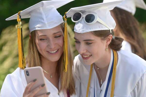 Heidi Lee Hoffman, left, and Alizabeth M. Neville admire a photo they just took before the Joel Barlow High School 2019 Commencement Ceremony, Wednesday June 12, 2019, at The O'Neill Center at Western Connecticut State University, Danbury, Conn.