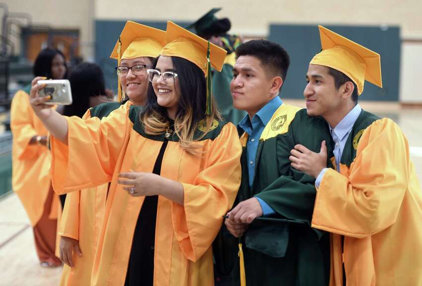 Graduates take a selfie before the start of Hamden High School commencement Wednesday.
