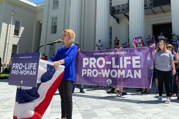 Beck Gerritson, president of Eagle Forum of Alabama, speaks at an anti-abortion rally outside the Capitol in Montgomery, Ala., on Wednesday, May 22, 2019. Groups that oppose abortion held the event to thank lawmakers who supported passage of a law that would virtually outlaw abortion in the state. (AP Photo/Kim Chandler)