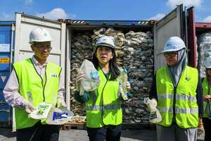 Minister of Energy, Science, Technology, Environment and Climate Change (MESTECC), Yeo Bee Yin (C) shows samples of plastics waste shipment from Australia before sending back to the country of origin in Port Klang, west of Kuala Lumpur on May 28, 2019. (Photo by Mohd RASFAN / AFP)MOHD RASFAN/AFP/Getty Images