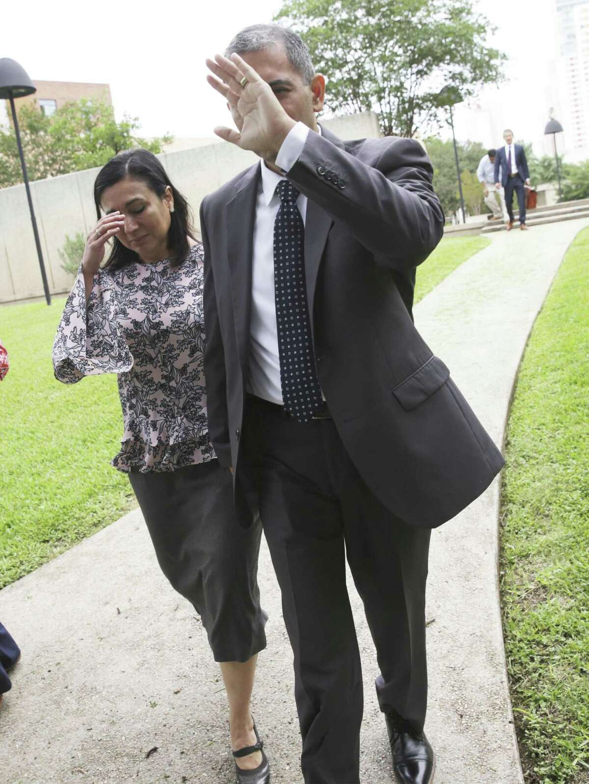 Enrique Gonzalez walks from the Federal Courthouse with his wife Gladys Gonzalez on June 12, 2019 after receiving a guilty verdict for lewd behavior charges aboard an airliner earlier this year.