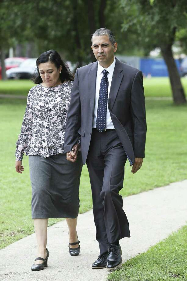 Enrique Gonzalez walks from the federal courthouse with his wife Gladys Gonzalez on Tuesday after he was found guilty on lewd behavior charges aboard an airliner earlier this year. Friday, he was fined $500 but no jail time. Photo: Tom Reel /Staff Photographer / 2019 SAN ANTONIO EXPRESS-NEWS