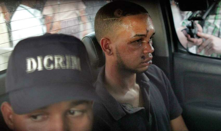 Eddy Vladimir Féliz Garcia, in custody in connection with the shooting of former Boston Red Sox slugger David Ortiz, is transferred by police to court in Santo Domingo, Dominican Republic, Tuesday, June 11, 2019. His lawyer, Deivi Solano, said Féliz Garcia had no idea who he?d picked up and what was about to happen, and that he expected Féliz Garcia would be charged as an accomplice to an attempted murder. (AP Photo/Roberto Guzman)