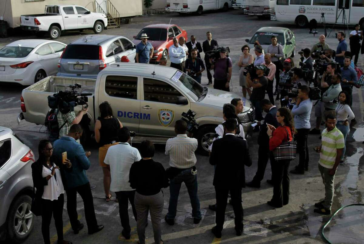 Journalists surround the police vehicle carrying Eddy Vladimir Féliz Garcia who was taken into custody in connection with the shooting of former Boston Red Sox slugger David Ortiz, as he is taken to court in Santo Domingo, Dominican Republic, Tuesday, June 11, 2019. His lawyer, Deivi Solano, said Féliz Garcia had no idea who he?d picked up and what was about to happen, and that he expected Féliz Garcia would be charged as an accomplice to an attempted murder. (AP Photo/Roberto Guzman)