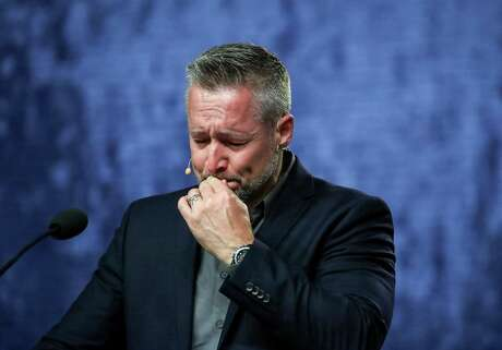 J. D. Greear, president of the Southern Baptist Convention, becomes emotional while talking about sexual abuse within the SBC on the second day of the SBC's annual meeting on Wednesday, June 12, 2019, in Birmingham.