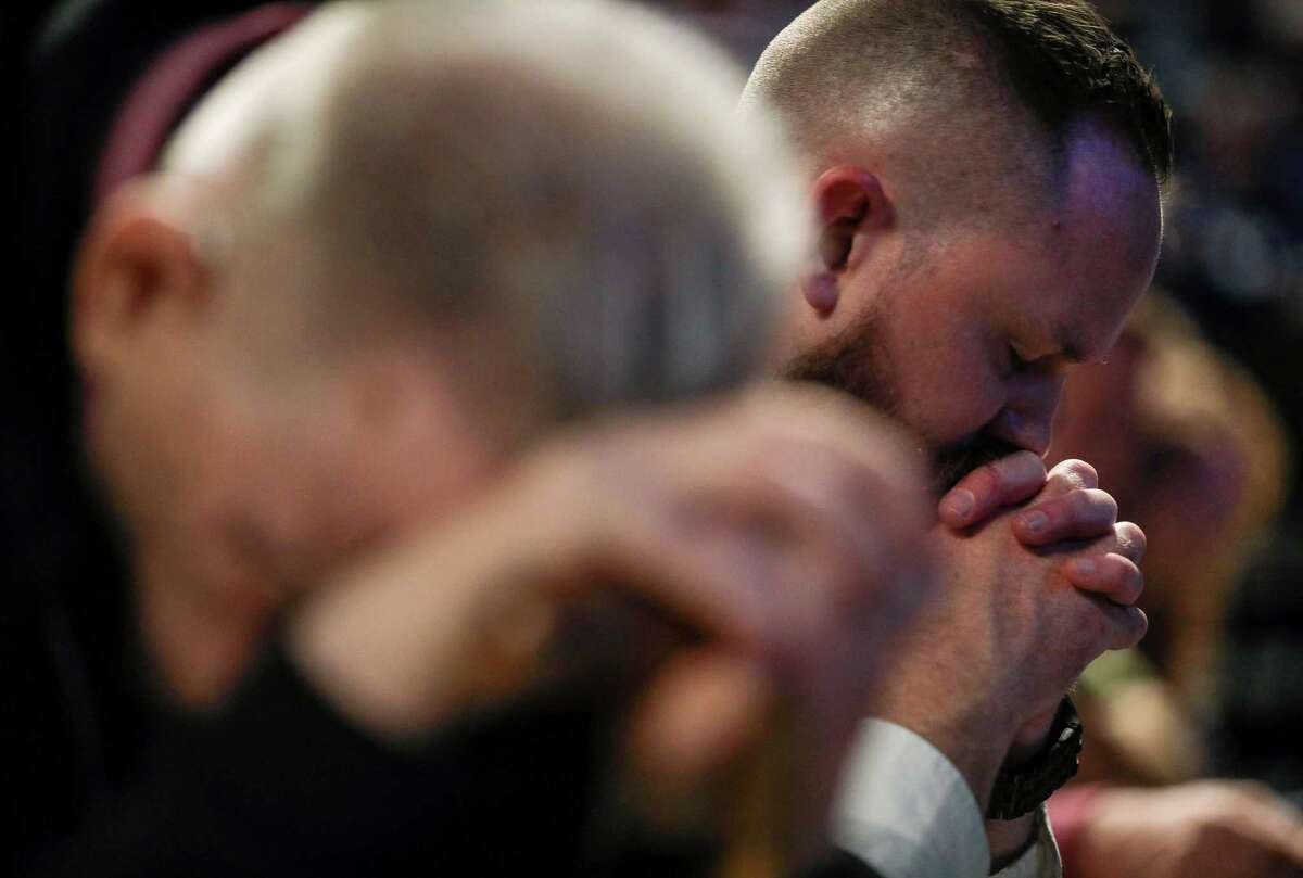 Joel Miller, a missions and outreach pastor, prays on the second day of the Southern Baptist Convention's annual meeting on Wednesday, June 12, 2019, in Birmingham.