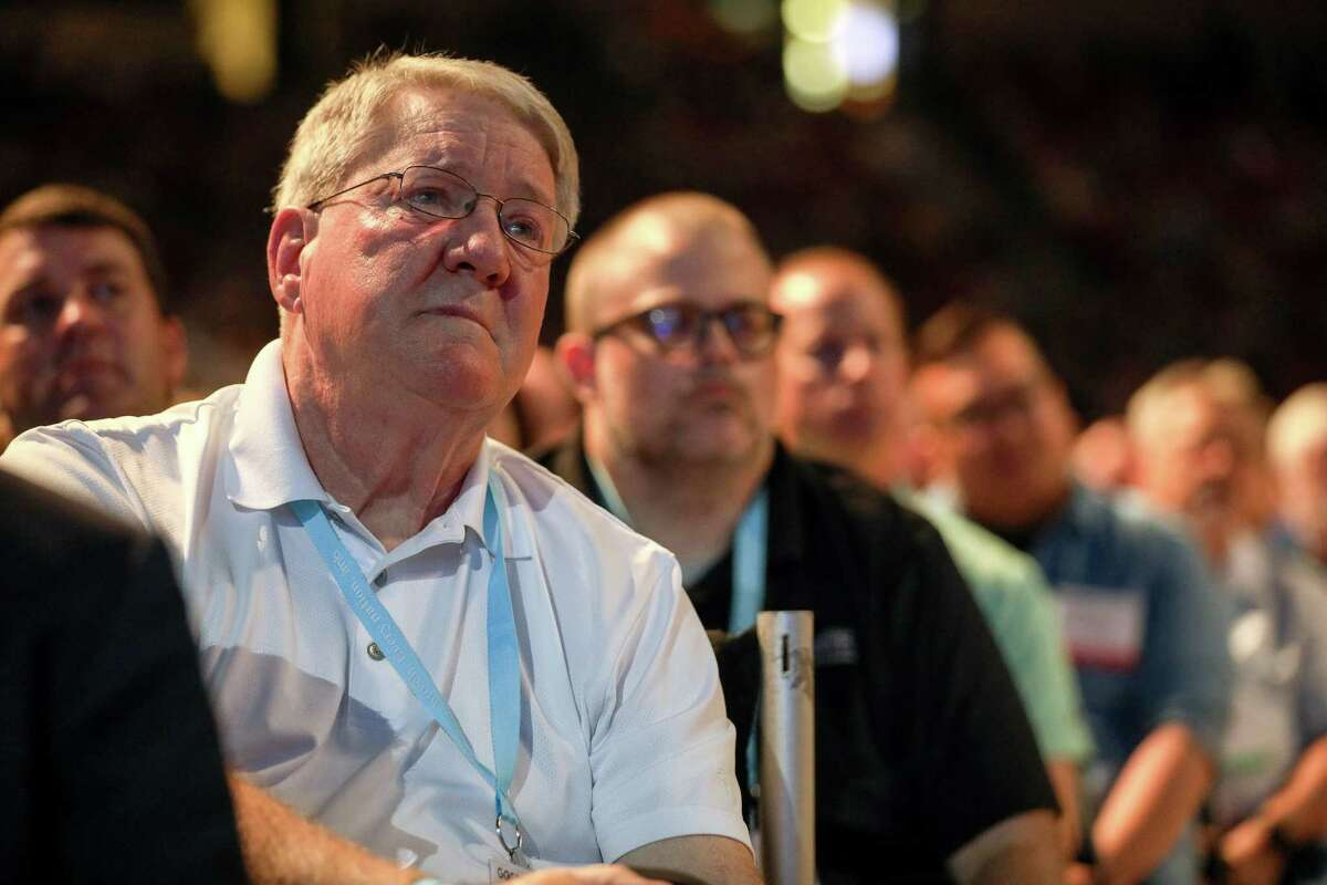 """Lynn Greear, father of Southern Baptist Convention President J. D. Greear, cries while listening to his son talk about sexual abuse within the SBC on the second day of the SBC's annual meeting on Wednesday, June 12, 2019, in Birmingham. """"Seeing my son up there, I'm very thankful God has used him to bring this to light,"""" Greear said."""