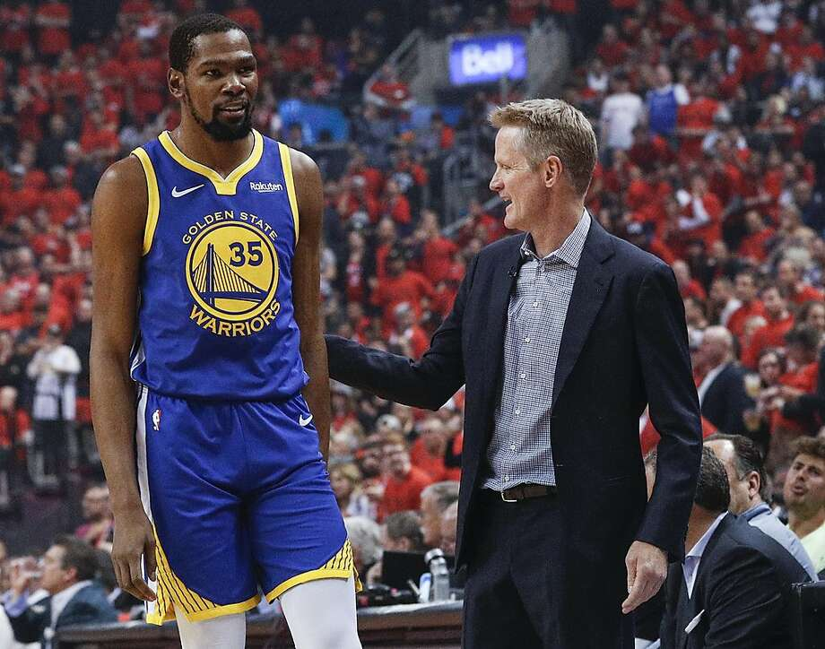 FILE - Golden State Warriors' head coach Steve Kerr gives Kevin Durant a pat on the back in the first quarter during game 5 of the NBA Finals between the Golden State Warriors and the Toronto Raptors at Scotiabank Arena on Monday, June 10, 2019 in Toronto, Ontario, Canada. Photo: Carlos Avila Gonzalez / The Chronicle