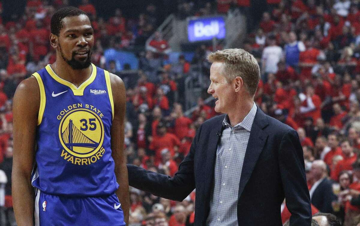 Golden State Warriors' head coach Steve Kerr gives /Kevin Durant a pat on the back in the first quarter during game 5 of the NBA Finals between the Golden State Warriors and the Toronto Raptors at Scotiabank Arena on Monday, June 10, 2019 in Toronto, Ontario, Canada.