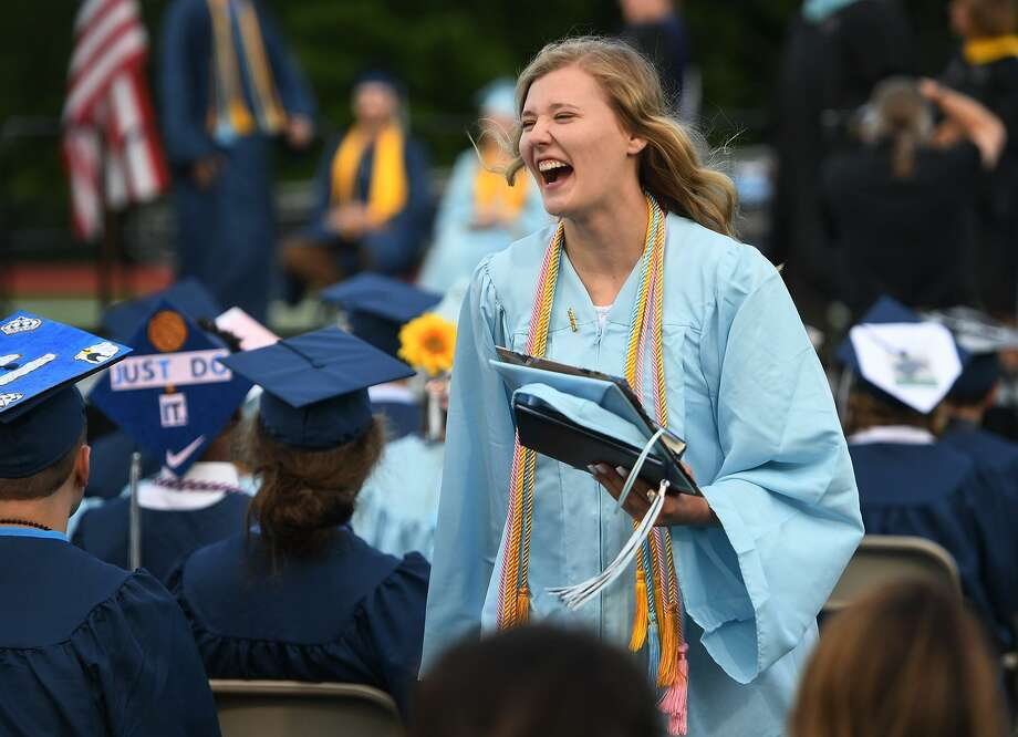 Graduate Olivia Potter celebrates after receiving her diploma at the Oxford High School Graduation in Oxford, Conn. on Tuesday, June 11, 2019. Potter's mother is Oxford High School Principal Dorothy Potter, who presented her daughter her diploma on stage. Photo: Brian A. Pounds / Hearst Connecticut Media / Connecticut Post