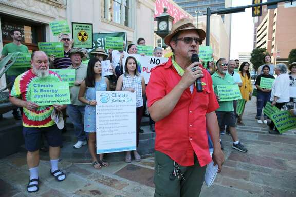 Sierra Club's Greg Harman kicks off a rally with several activism and environmental groups on the steps of Municipal Plaza, June 12. CPS's low energy score has discouraged a reader who thinks the energy company should work faster to improve it.