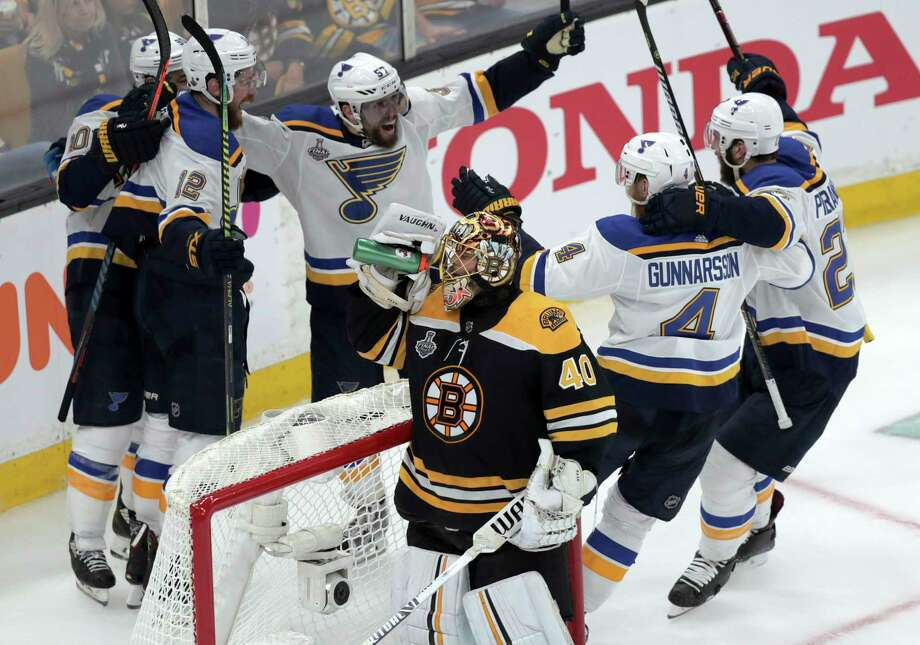 St. Louis Blues' Zach Sanford (12) celebrates his goal with teammates behind Boston Bruins goaltender Tuukka Rask (40), of Finland, during the third period in Game 7 of the NHL hockey Stanley Cup Final, Wednesday, June 12, 2019, in Boston. (AP Photo/Charles Krupa) Photo: Charles Krupa / Copyright 2019 The Associated Press. All rights reserved