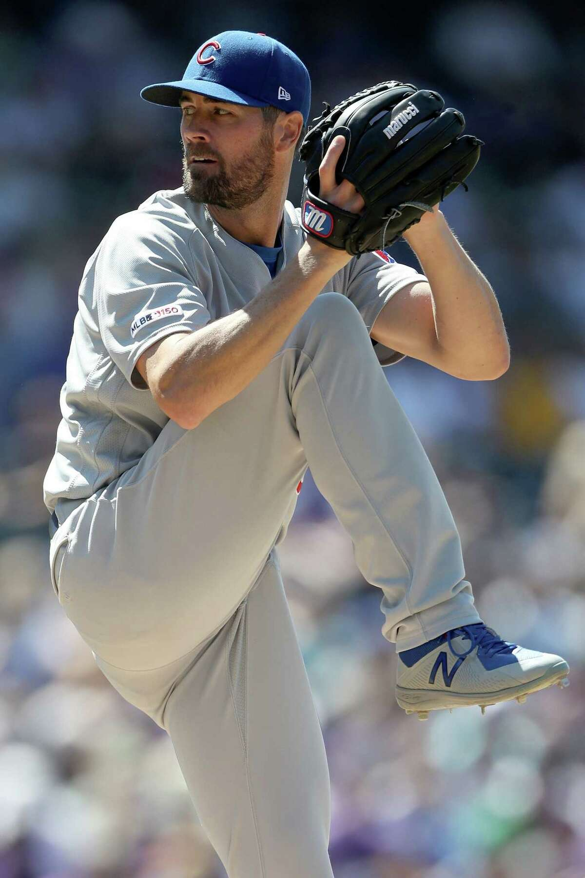 DENVER, COLORADO - JUNE 12: Starting pitcher Cole Hamels #35 of the Chicago Cubs throws in the seventh inning against the Colorado Rockies at Coors Field on June 12, 2019 in Denver, Colorado. (Photo by Matthew Stockman/Getty Images)